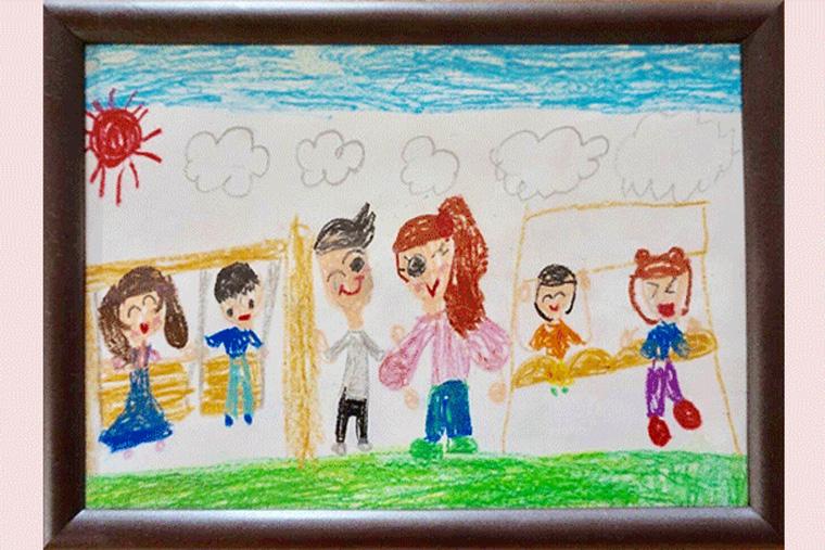 子どもが書いた佐藤賢さんの似顔絵